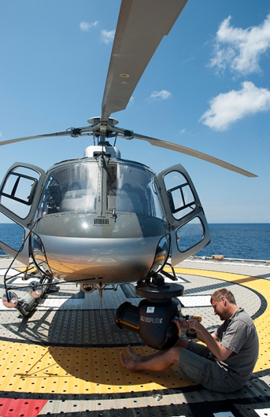 Picture shows: MAKING OF - Cameraman Ted Giffords in the Pacific Ocean off Costa Rica. To find the 'boiling sea', the Blue Planet II team needed to search vast areas of open ocean. A helicopter deployed from the M/V Umbra allowed the team to find and film this fabled open ocean phenomenon for the first time.